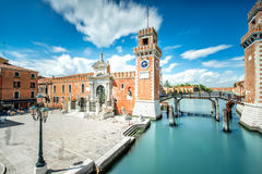 Venetian Arsenal in Venice. Venetian Arsenal in Castello region in Venice. Long exposure image technic with motion blurred clouds royalty free stock images