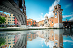 Venetian Arsenal in Venice. View on venetian Arsenal with reflection on the water in Castello region in Venice. Long exposure image technic with motion blurred royalty free stock image