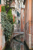Venetian backstreet with bridge over the canal Stock Photo