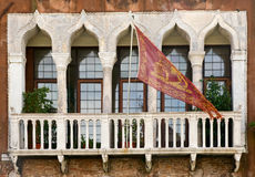 Venetian balcony. With flag, Venice, Italy Royalty Free Stock Photo