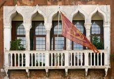 Venetian balcony. With flag, Venice, Italy royalty free stock photo