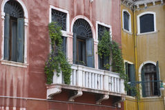 Venetian balcony on colorful house Royalty Free Stock Photo