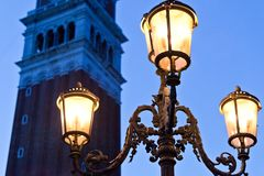 Venetian Bell Tower with lamp in evening Royalty Free Stock Photo