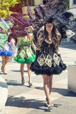Venetian black costumes, beautiful girl parading in the street Stock Photography