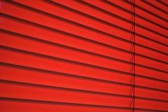 Venetian blind in red. Plastic venetian blind in red Stock Photos