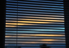 Venetian blinds. On the window and dusk behind stock photos
