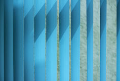 Venetian blinds. Blue toned. Vertical Blinds Curtain for nice blue background Royalty Free Stock Images