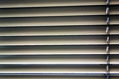 Venetian blinds for shade at the window. To protect against heat and sun blinds are attached to a window Stock Photos