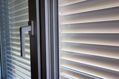 Venetian blinds for shade at the window Royalty Free Stock Photography