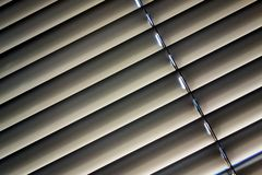 Venetian blinds for shade at the window. To protect against heat and sun blinds are attached to a window Royalty Free Stock Photography