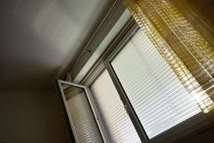 Venetian blinds for shade at the window Stock Photography