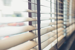 Venetian blinds by the window Royalty Free Stock Image