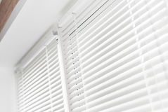 Venetian blinds. Windows with white venetian blinds stock photos