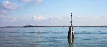 Venetian buoy along fairway channel Royalty Free Stock Images