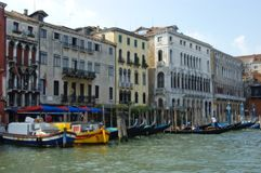 Venetian canal. Architecture and a waterway with boats and a gondola in Venice, Veneto, Italy stock image
