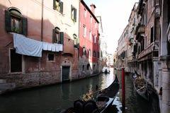 Venetian canal with black gondola Royalty Free Stock Photos