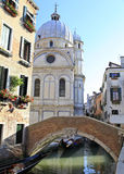 Venetian canal with the church of Santa Maria dei Miracoli in the background Royalty Free Stock Images