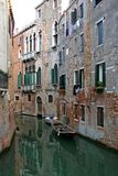 Venetian canal and gondola royalty free stock photography