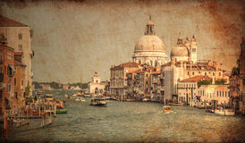 Venetian canal and gondolas. Vintage style photo. Venetian canal and gondolas Royalty Free Stock Image