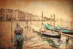 Venetian canal and gondolas. Vintage style photo. Venetian canal and gondolas Stock Image