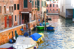 Venetian canal, Italy. Traditional venetian canal with boats, Italy Royalty Free Stock Images