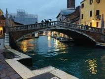 Venetian canal under the winter rain royalty free stock photo