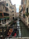 Venetian canal view from a bridge with gondolas royalty free stock image