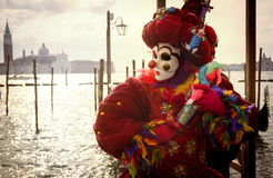 Venetian Carnival clown with puppet Royalty Free Stock Images