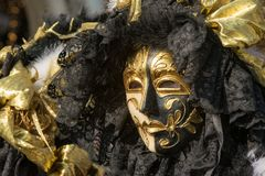 Traditional venetian carnival costume mask. Venetian carnival costume mask during traditional masquerade in city of Venice Italy Stock Photo