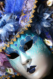 Venetian carnival mask. Blue, varied stock images