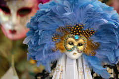 Venetian carnival mask with feather Stock Images