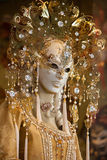 Venetian carnival mask. Gold and white, varied Stock Image