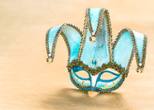 Venetian carnival mask over golden background Royalty Free Stock Image