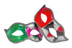 Venetian Carnival Mask   patterned asymmetrical frontal picture. Two Venetian carnival half-mask silver red green black pink asymmetry pattern isolated white Stock Photos