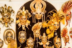 Venetian carnival masks hanging in a shop stock photos