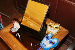 Venetian carnival masks. Party masks on a table. Stock Images