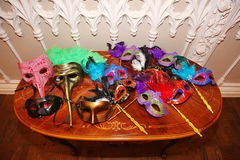 Venetian carnival masks. Party masks on a table. Royalty Free Stock Photos