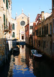 Venetian chanel. Street scenic in Venice. View on the church, chanel and old venetian houses Royalty Free Stock Images