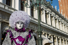 Venetian costume attends Carnival of Venice. Royalty Free Stock Image