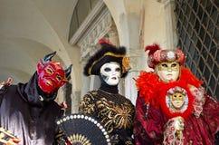 Venetian costume attends Carnival of Venice. Stock Photo