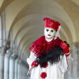 Venetian costume attends Carnival of Venice. Royalty Free Stock Images