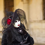 Venetian costume attends Carnival of Venice. Royalty Free Stock Photo