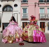 Venetian costumes. Venice,Italy- February 26th, 2011: Image of two women with venetian masks and complicate gowns during the Carnival of Venice.The Carnival of Stock Photography