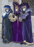 Venetian Costumes. Venice, Italy- February 19th, 2012: A group of three people in traditional costumes posing during the Venice Carnival days Stock Photo