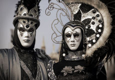 Venetian couple in black and silver costume Royalty Free Stock Photo