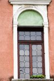 Venetian craftsmanship on display with window on historic buildings in Venice, Italy. Focus on details of Venetian artistry on display throughout the city Royalty Free Stock Photography