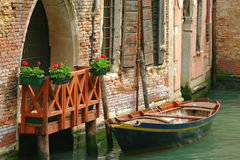 Venetian Curbside Parking. A boat parked in a canal alongside an entrance to a building in Venice, Italy Royalty Free Stock Photo