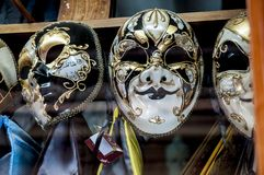 Venetian decorated masks. With white, black and gold ornaments in a shop window Royalty Free Stock Photos