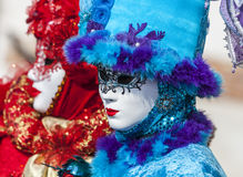 Venetian Disguise. Venice,Italy-February 18, 2012: Portrait of a persons wearing a mask and a specific blue disguise in venice during the Carnival days Stock Images