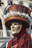 Venetian Disguise. Venice, Italy- February 18th, 2012: Portrait of a person wearing a beautiful mask and disguise during the Venice Carnival Royalty Free Stock Photos